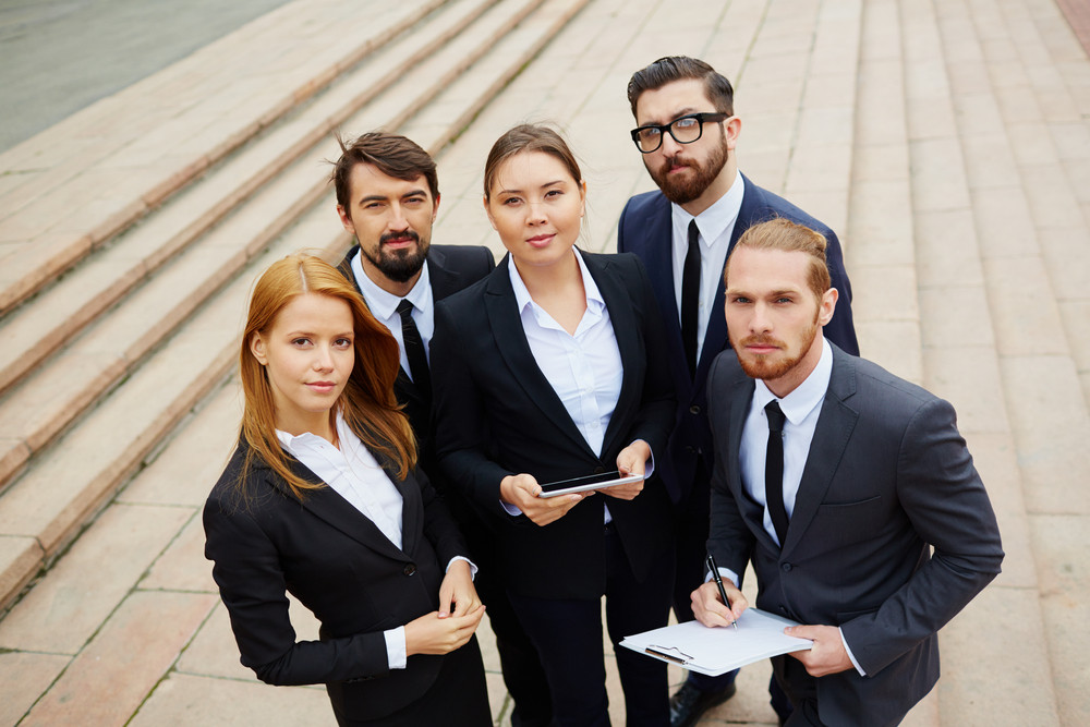 Group Of Smart Business Partners Looking At Camera