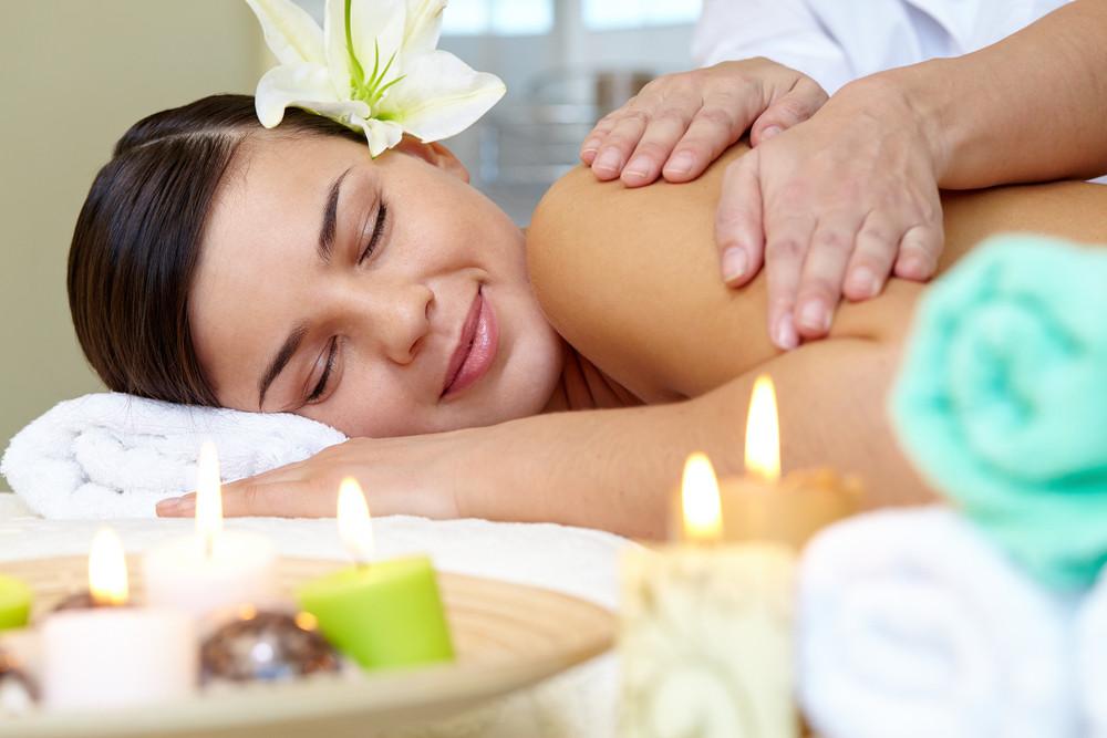 Portrait Of Young Female Enjoying The Procedure Of Massage