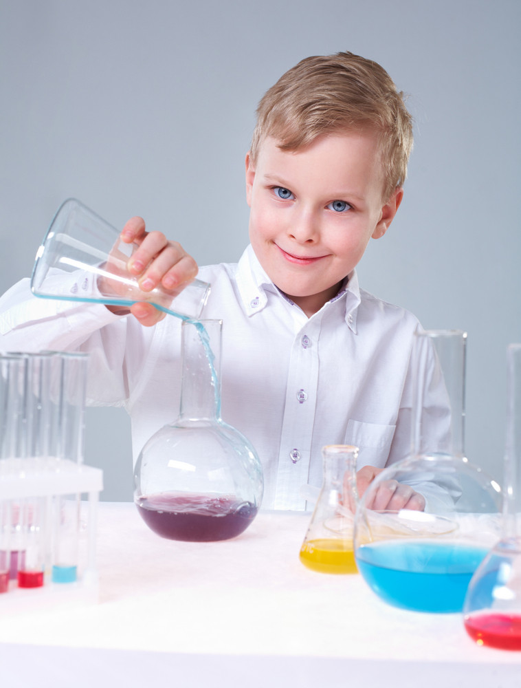 Vertical Portrait Of A Lovely Boy Making Scientific Research
