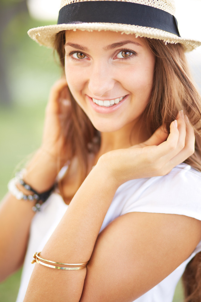 Happy Girl In Hat Looking At Camera With Smile