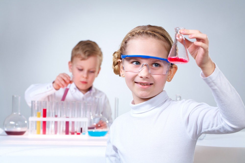 Girl In The Foreground Holding A Flask With Experimental Substance