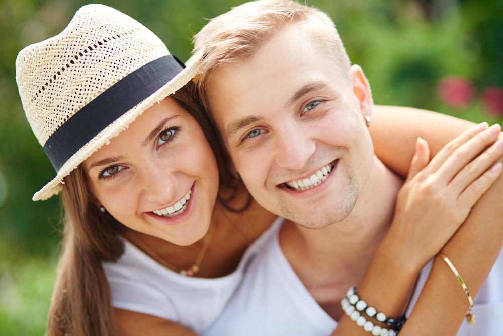 Joyful Couple Looking At Camera