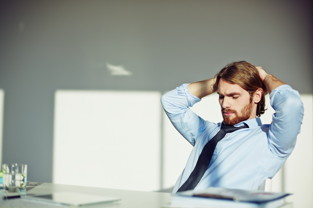 Office Worker Taking A Pause At His Workplace