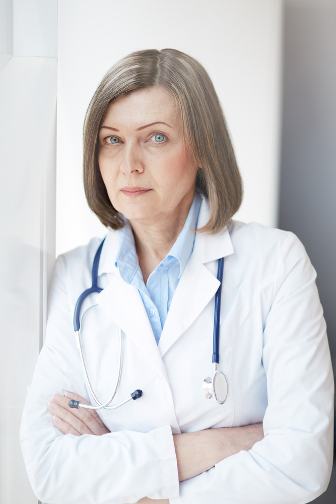 Portrait Of Successful Female Practitioner Looking At Camera