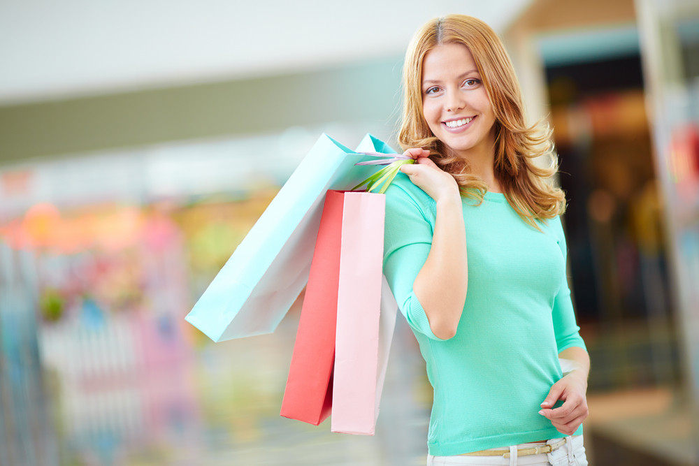 Portrait Of Stylish Girl With Shopping Bags Looking At Camera With Smile