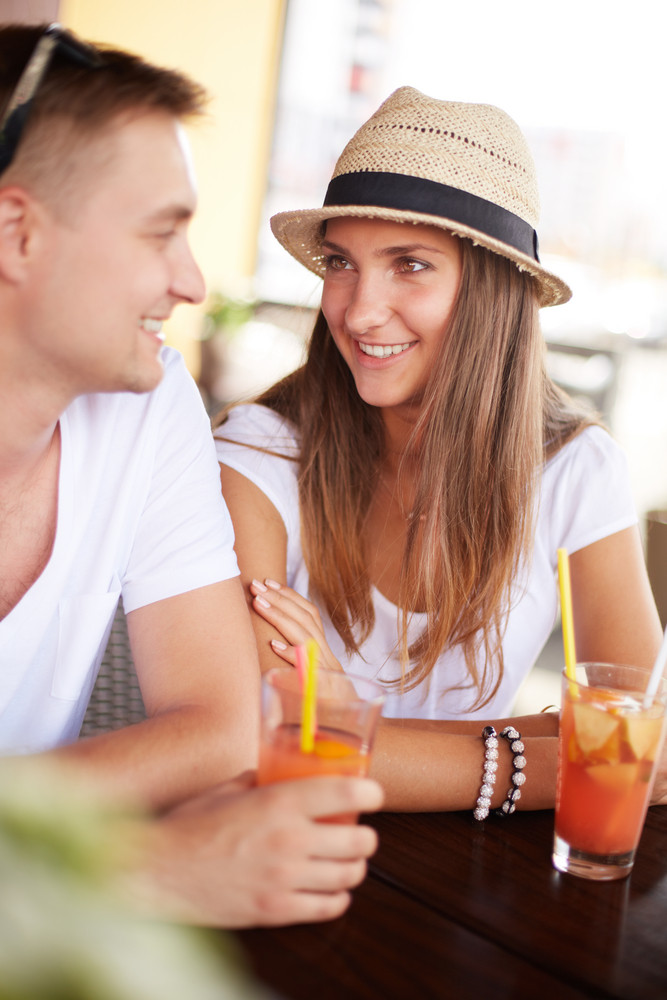 Happy Guy And His Girlfriend Sitting In Cafe On Summer Day