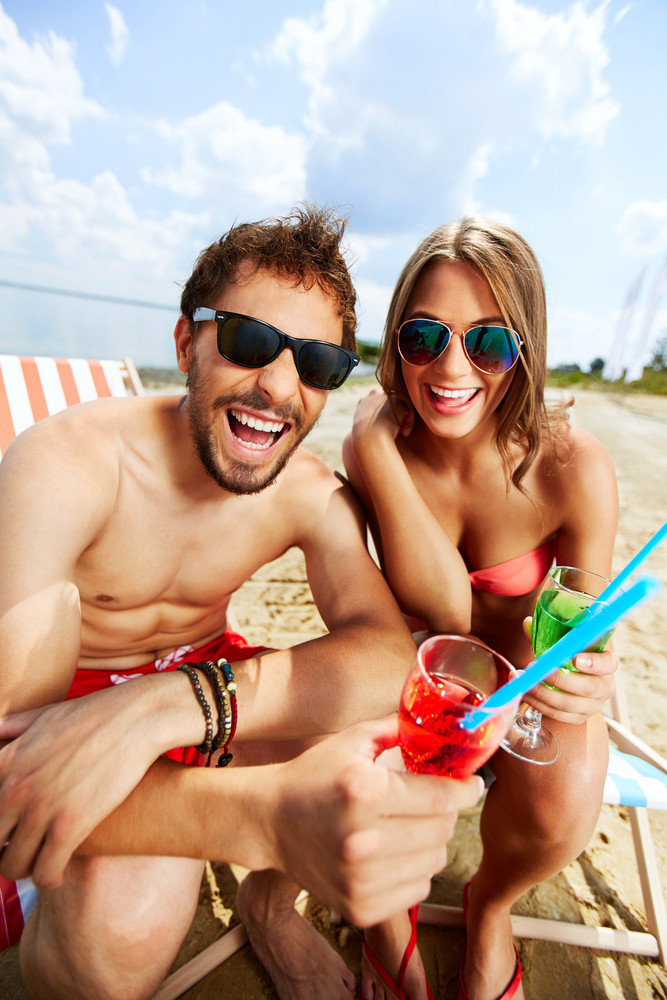 Relaxed Young Lovers Having Fun On The Beach On A Sunny Day