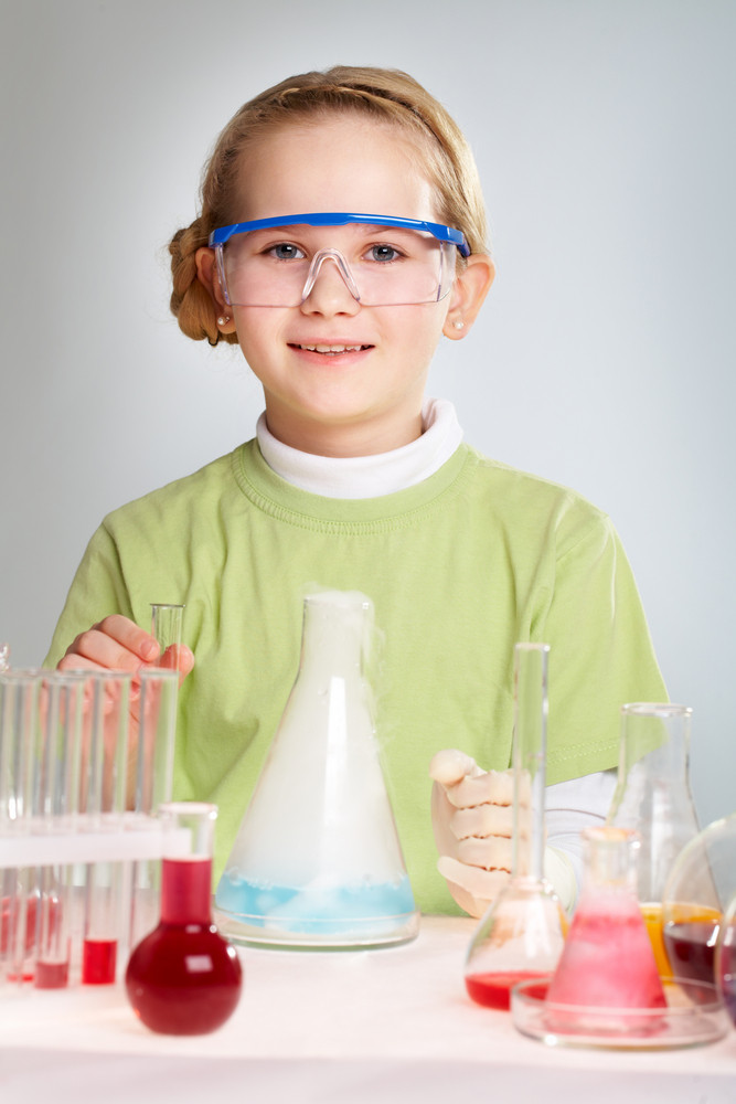 Cute Girl Observing A Reaction In A Scientific Laboratory