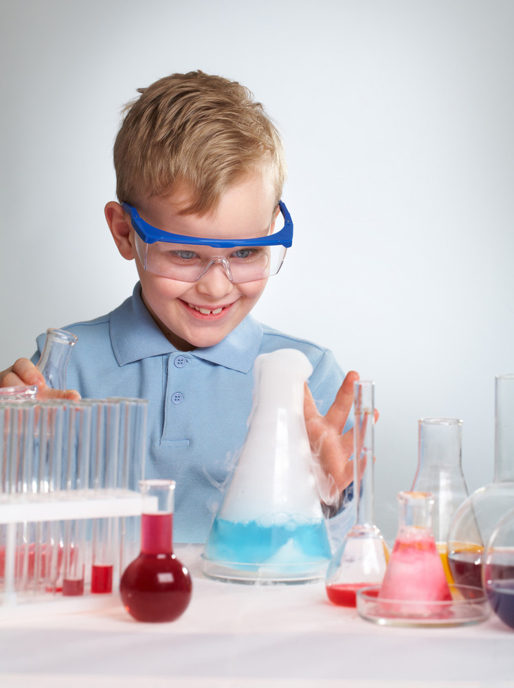 An Enthusiastic Boy Looking At The Results Of His Experiment