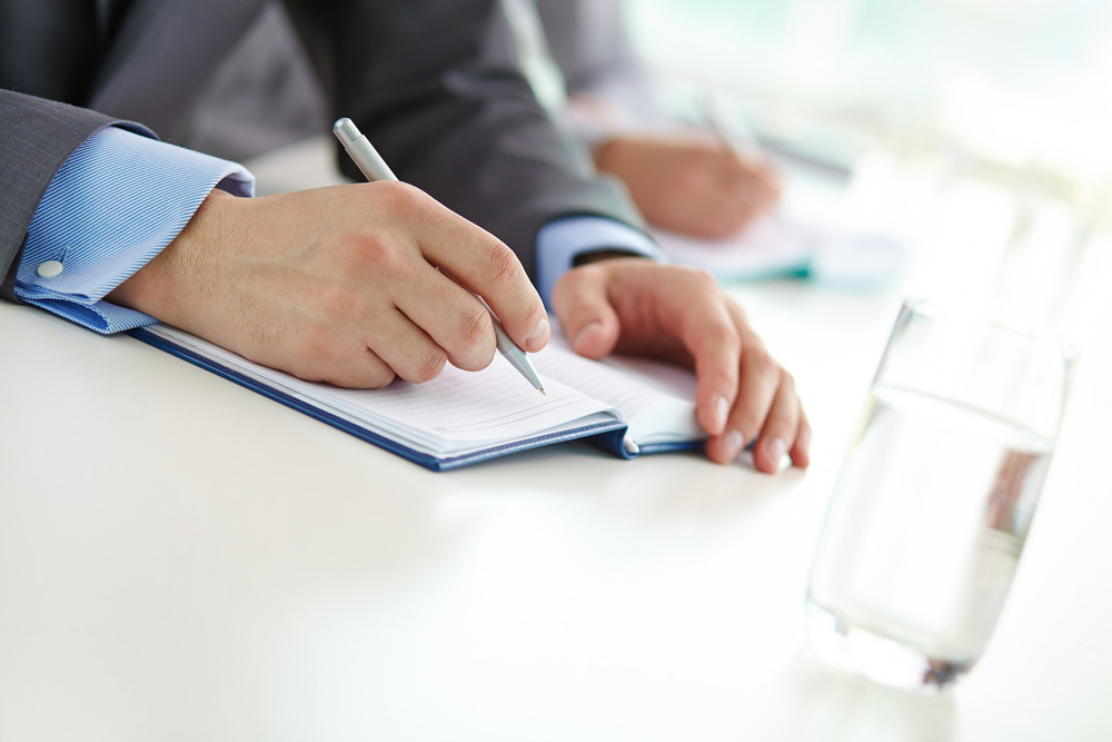 Hand Of Businessman With Ballpoint Writing Plan In Notebook