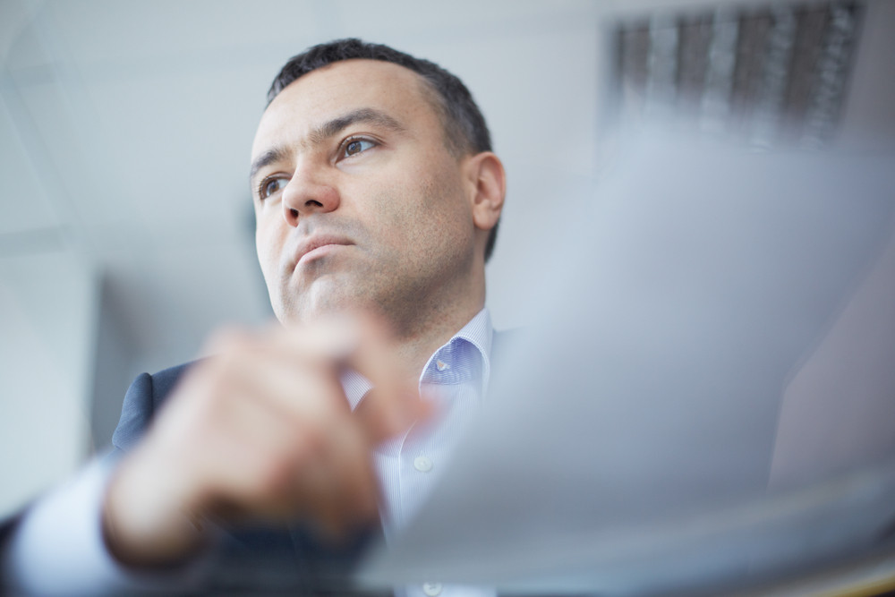 Close-up Of Businessman Face Viewed Through Glass Table