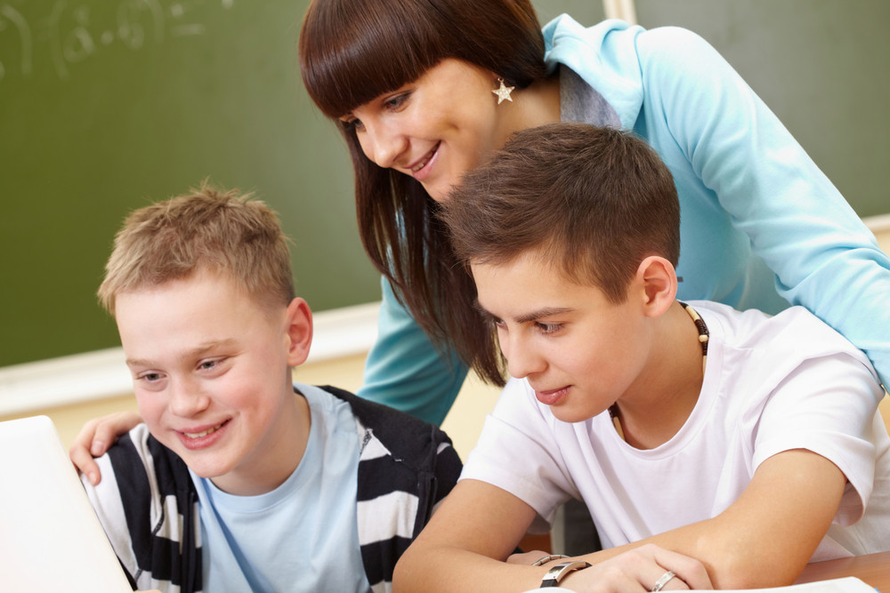 Portrait Of Two Guys And Girl Being Busy During Lesson
