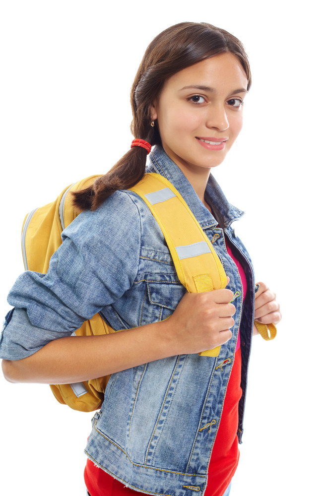 Cute Girl With Backpack Smiling At Camera In Isolation