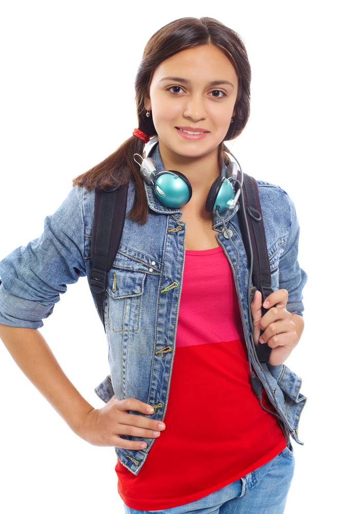 Cute Girl With Backpack And Headphones Smiling At Camera In Isolation