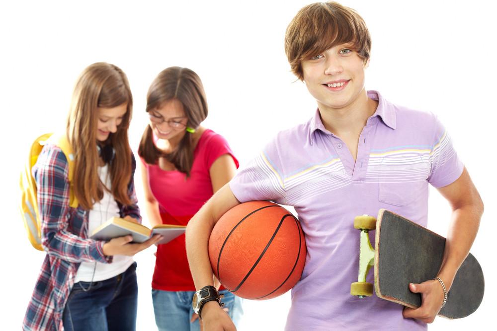 Active Teenager With Skateboard And Ball Looking At Camera