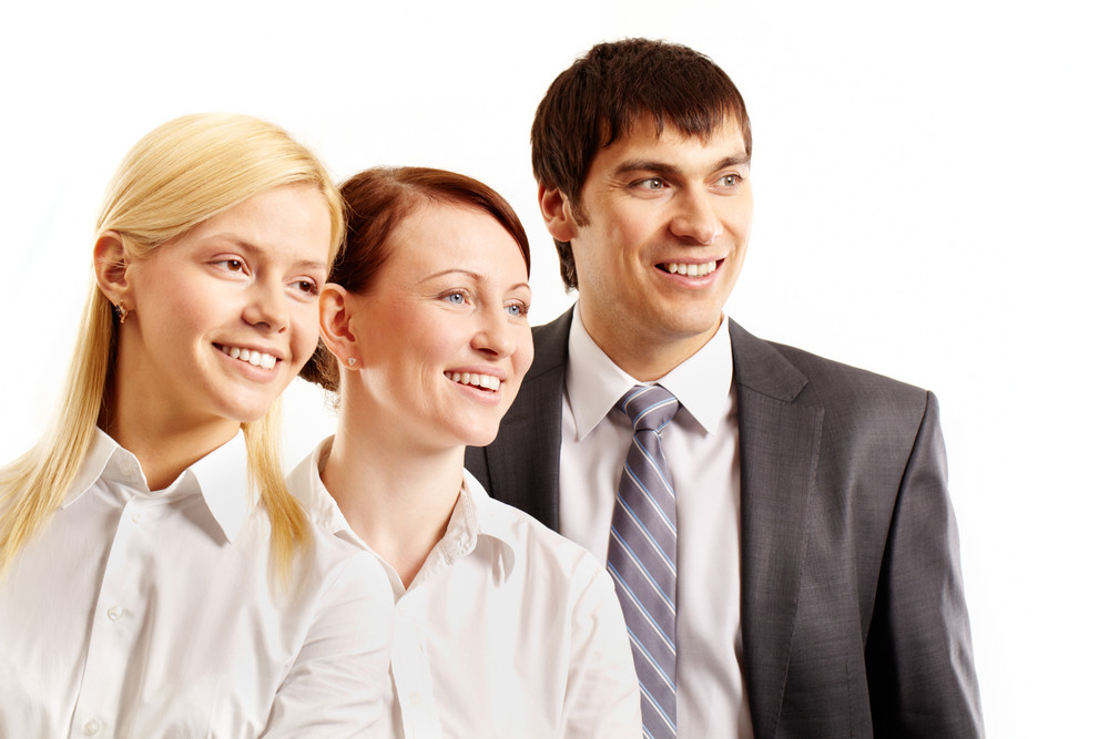 Three Confident Business People Smiling And Looking Away Isolated On White