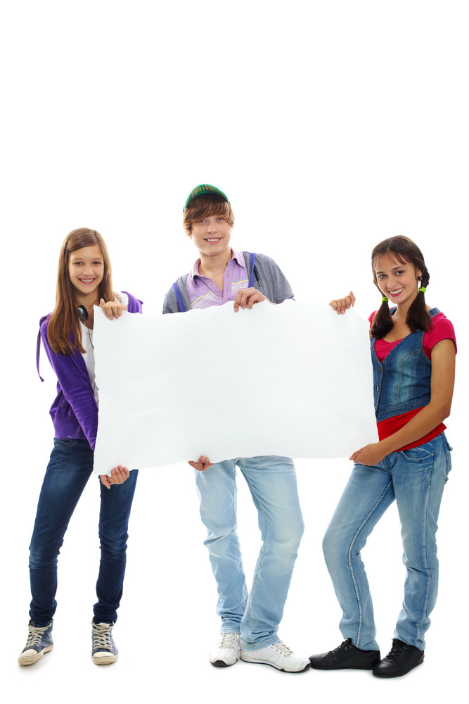 Three Teenagers In Casual Clothes Holding Blank Sheet Of Paper