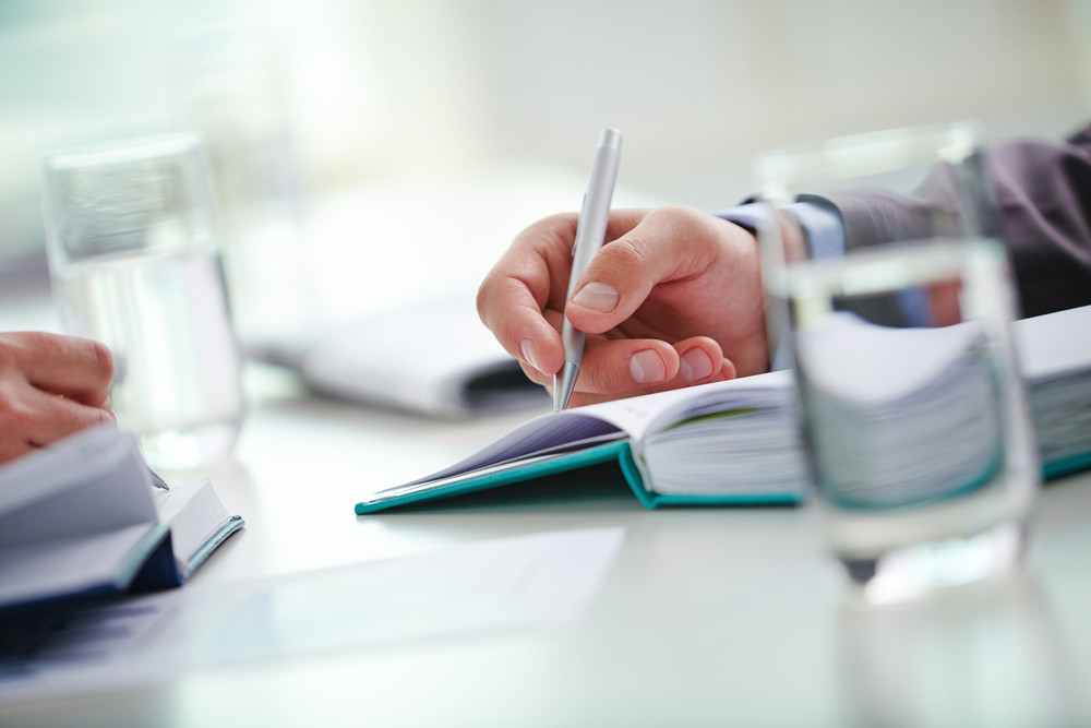 Male And Female Hands Making Notes Or Writing Working Plan