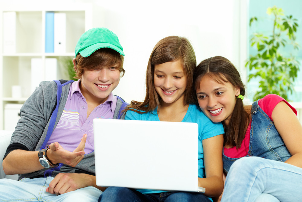 Three Teenagers Studying With Computer