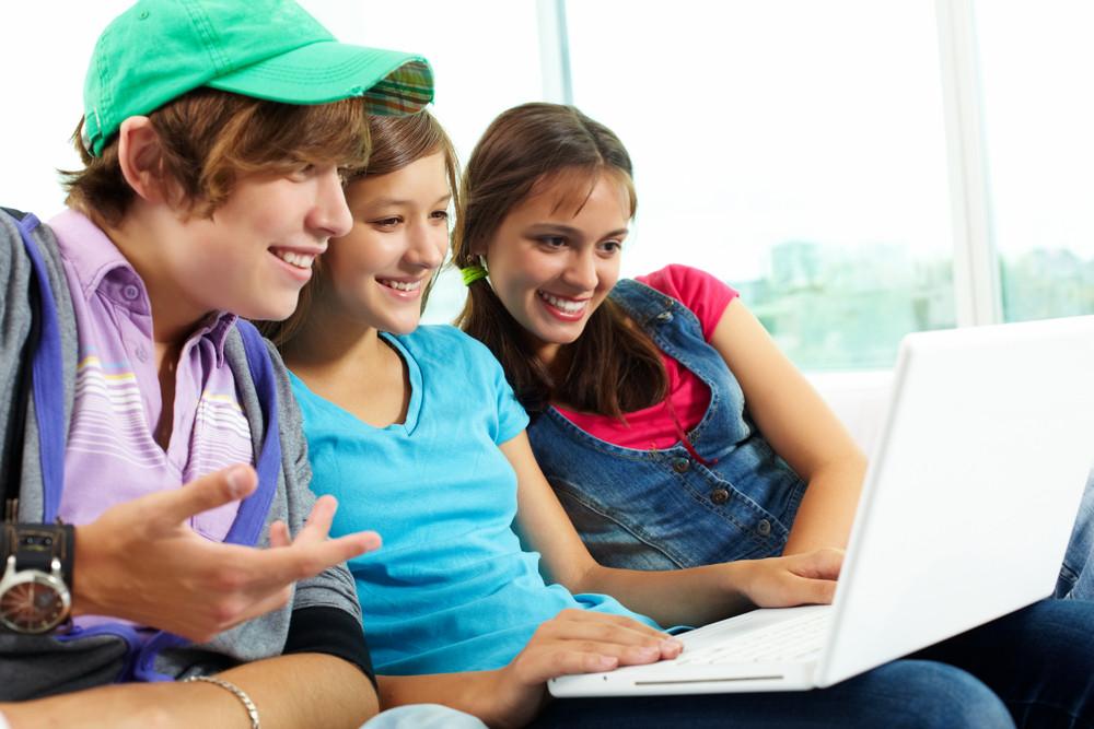 Three Teenagers Looking At Laptop Screen