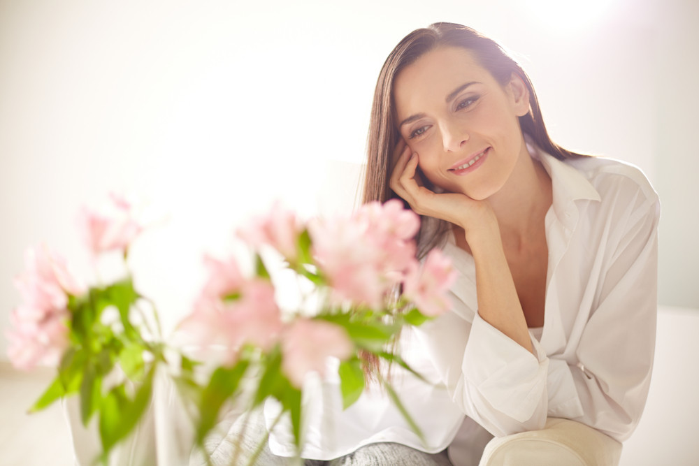 Portrait Of Lovely Lady Looking At Bunch Of Pink Flowers