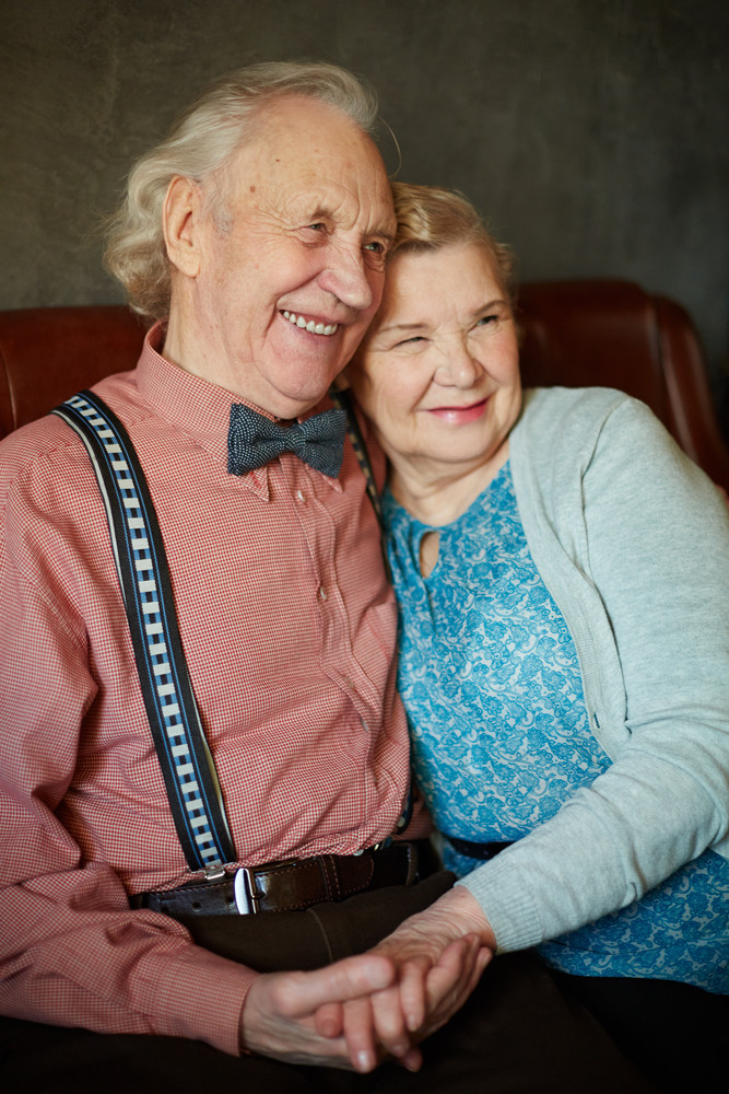 Portrait Of Retired Couple In Smart Clothes Having Rest