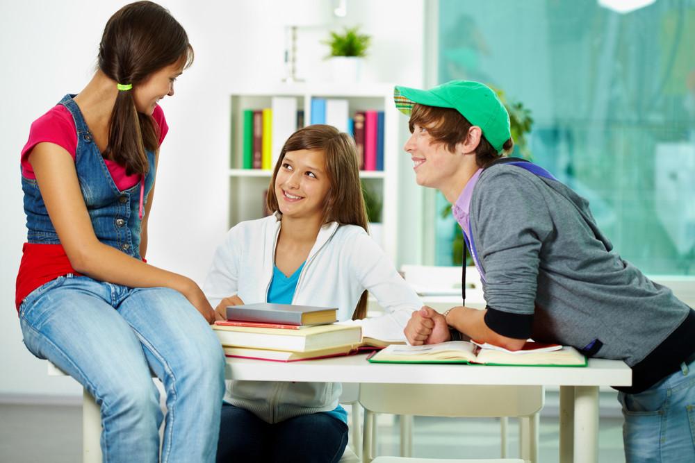 Portrait Of Smart Classmates Interacting At Break In College