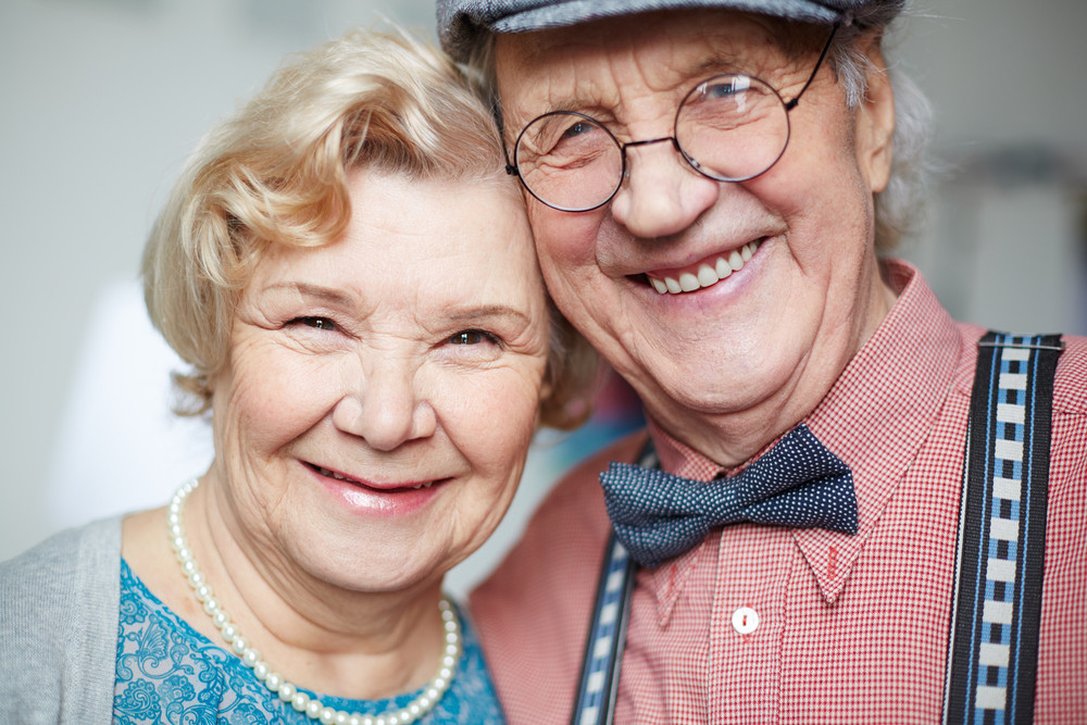Portrait Of Senior Couple In Smart Clothes Looking At Camera