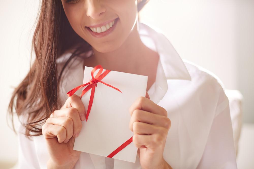 Image Of Smiling Female Holding Valentine Letter