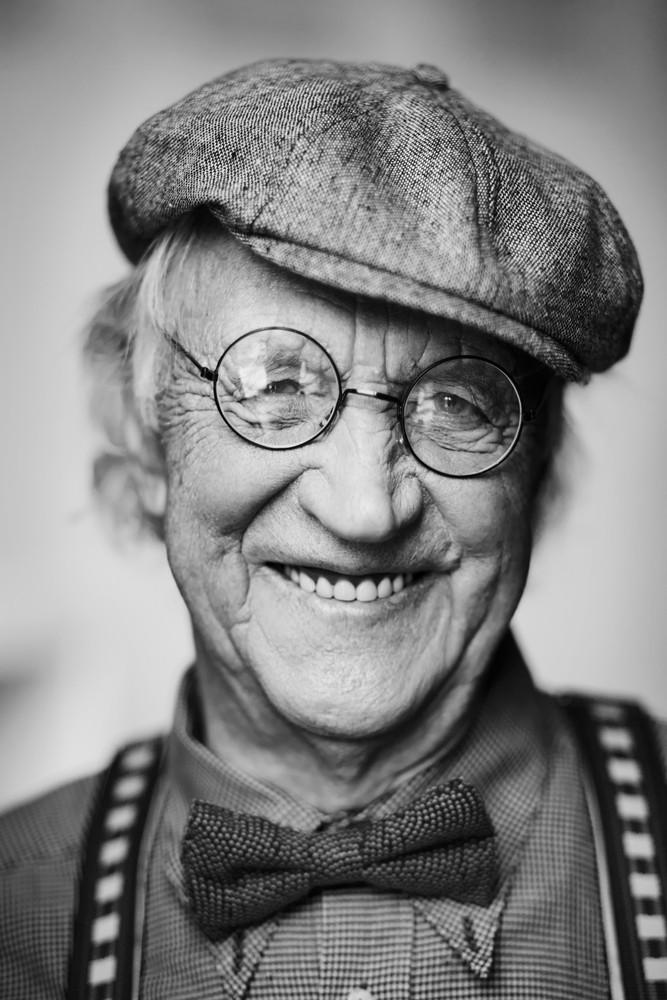 Portrait Of A Happy Senior Man Looking At Camera