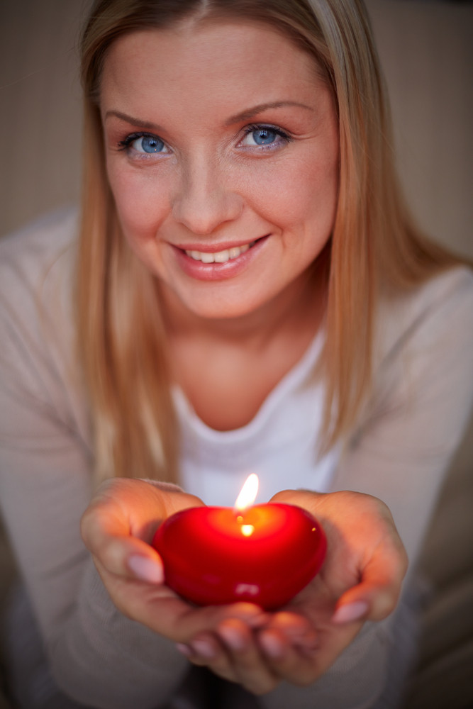 Image Of Smiling Female With Burning Candle Looking At Camera