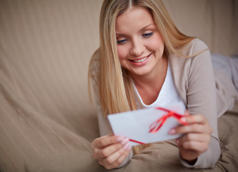 Image Of Smiling Female Reading Valentine Message