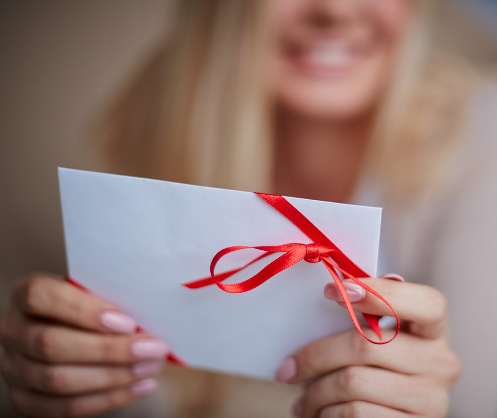 Image Of Young Female Holding Valentine Letter In Hands