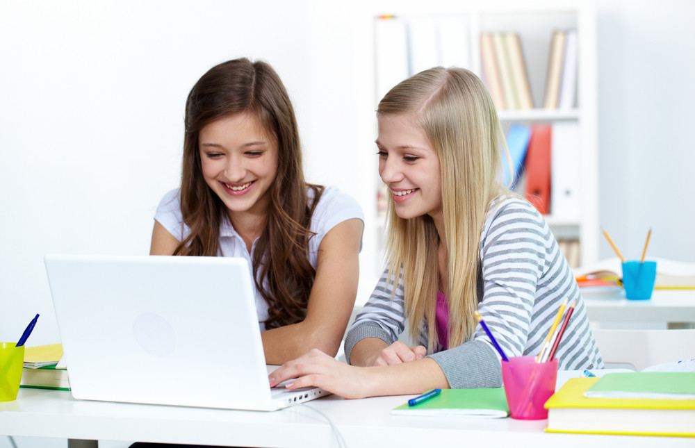 Cute Girls Working With Laptop In College
