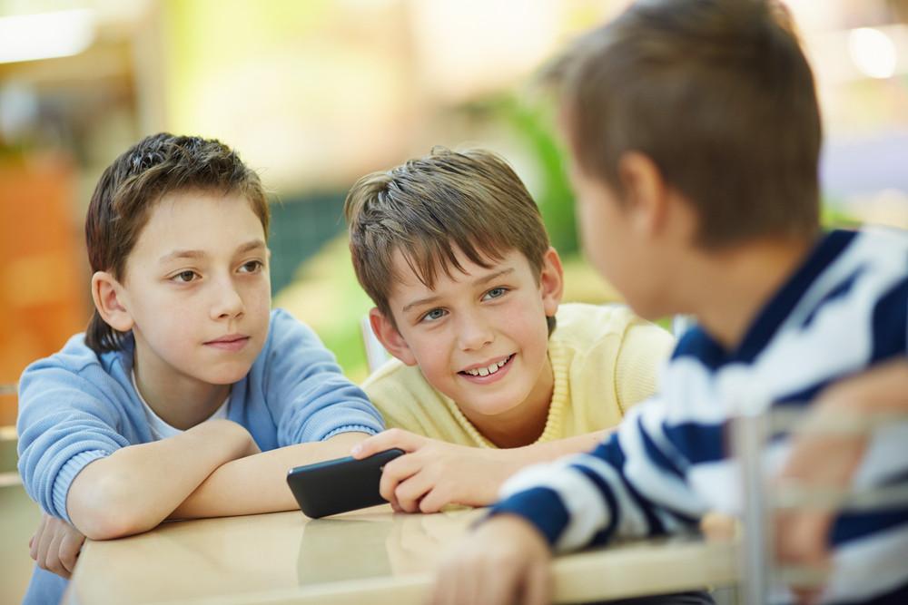 Three Boys Talking Indoors