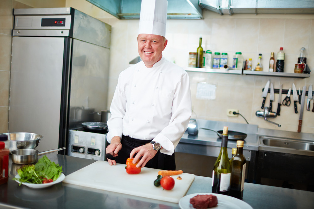 Image Of Male Chef With Knife And Vegs Preparing Salad
