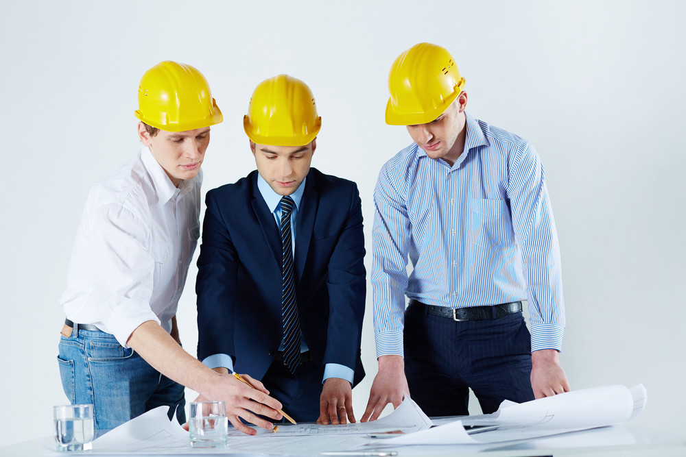 Image Of Young Engineers Working With The Business Project At The Workplace