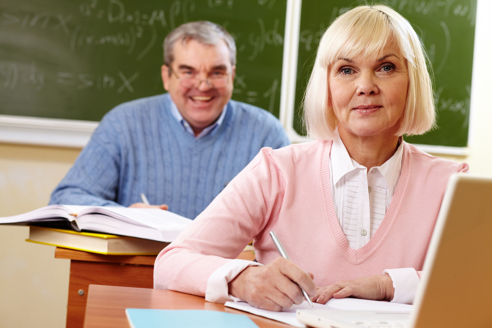Two Senior People At The Lesson Looking At Camera And Smiling