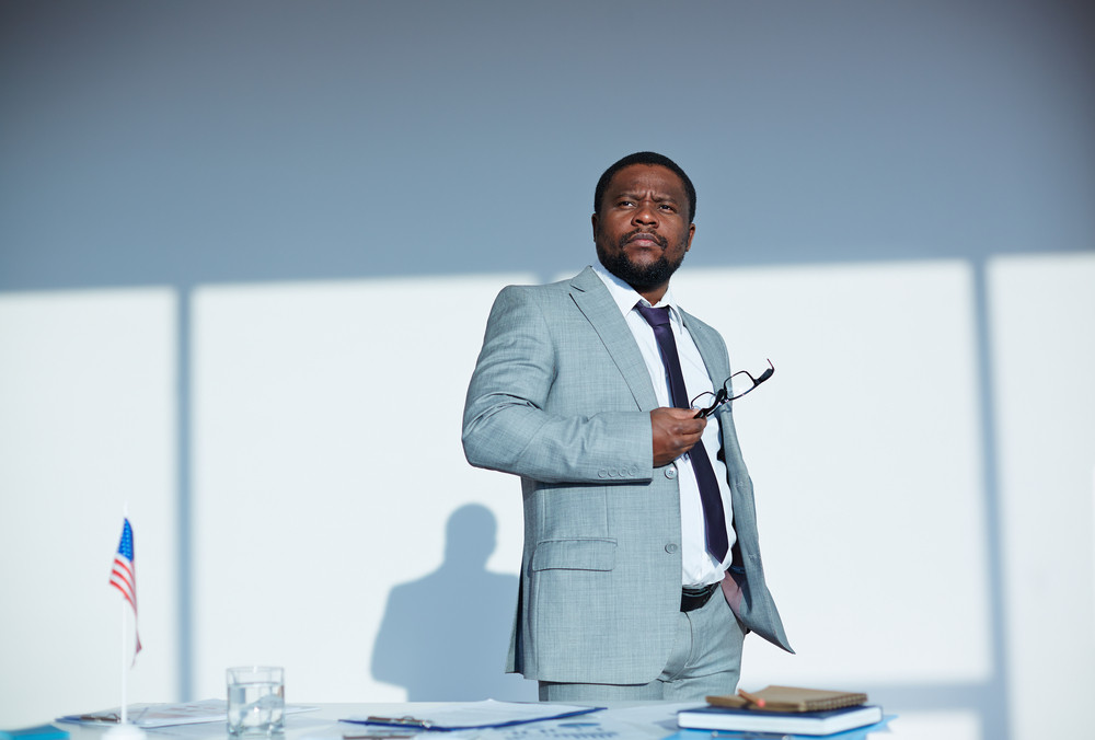 Pensive Businessman Of African Ethnicity Thinking Of Something