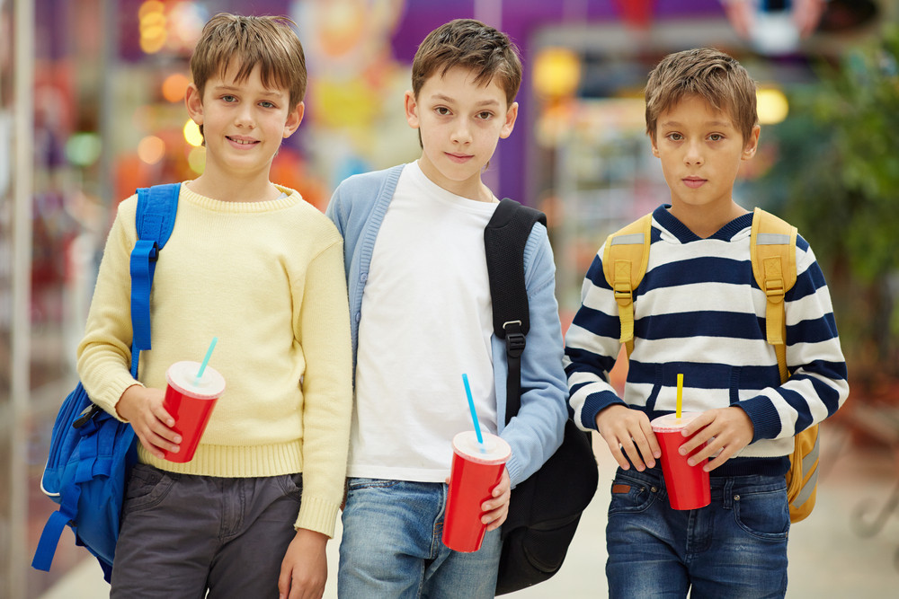 Portrait Of Three Serious Schoolboys With Soda