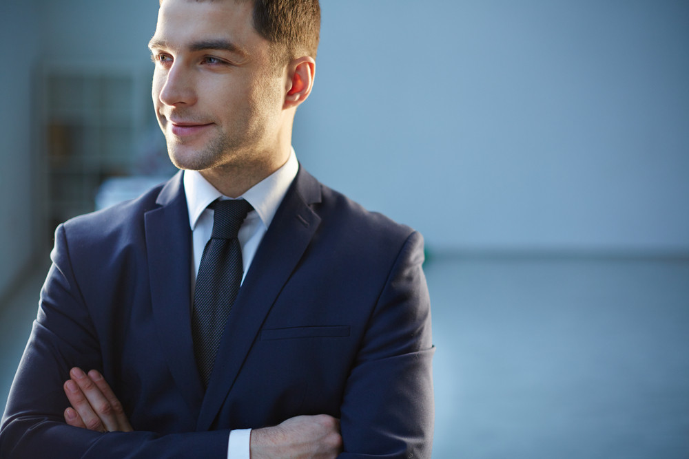 Closeup Image Of A Smiling Businessman On The Foreground