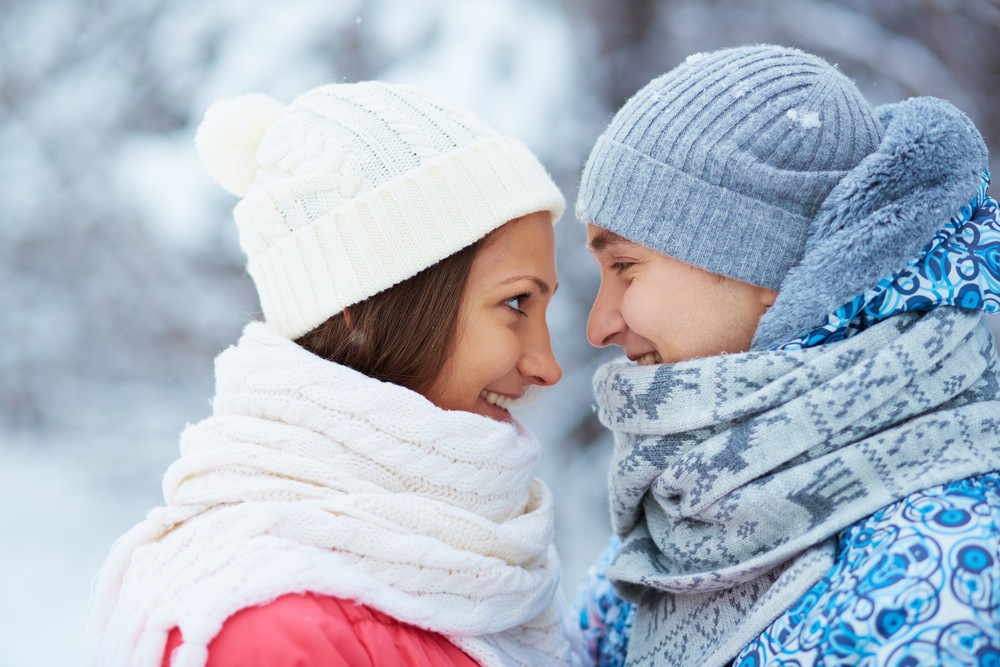 Profiles Of Happy Young Woman And Man In Winterwear Looking At One Another