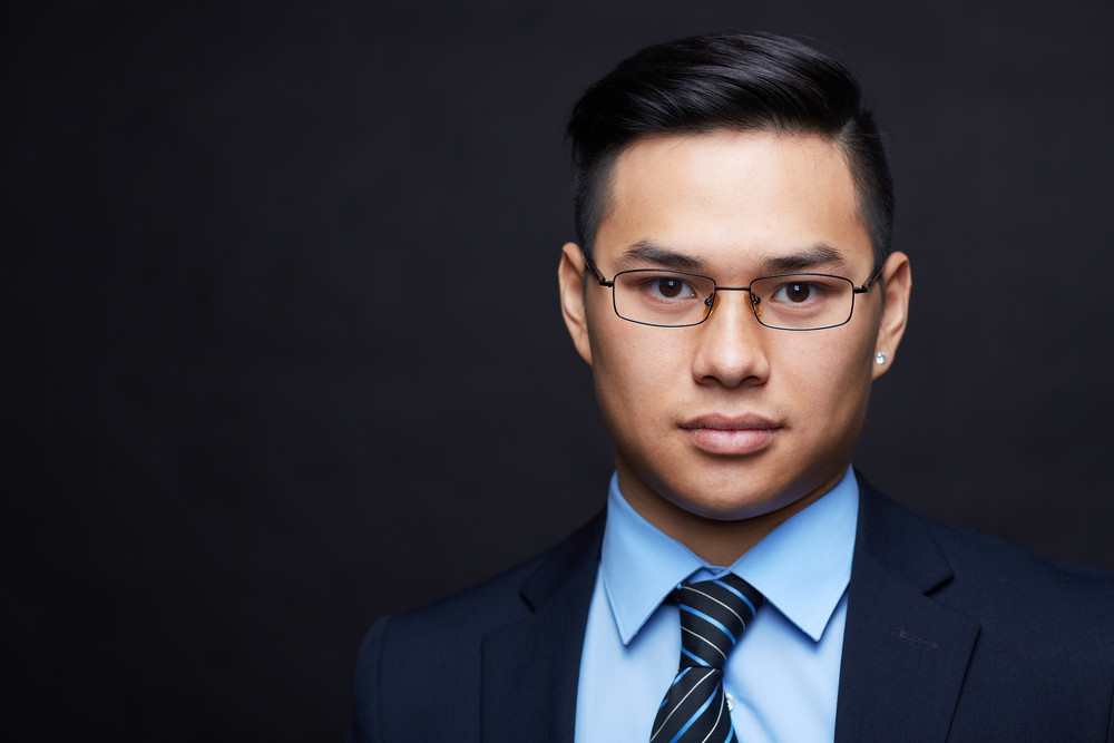 Smart Businessman In Formalwear And Eyeglasses Looking At Camera
