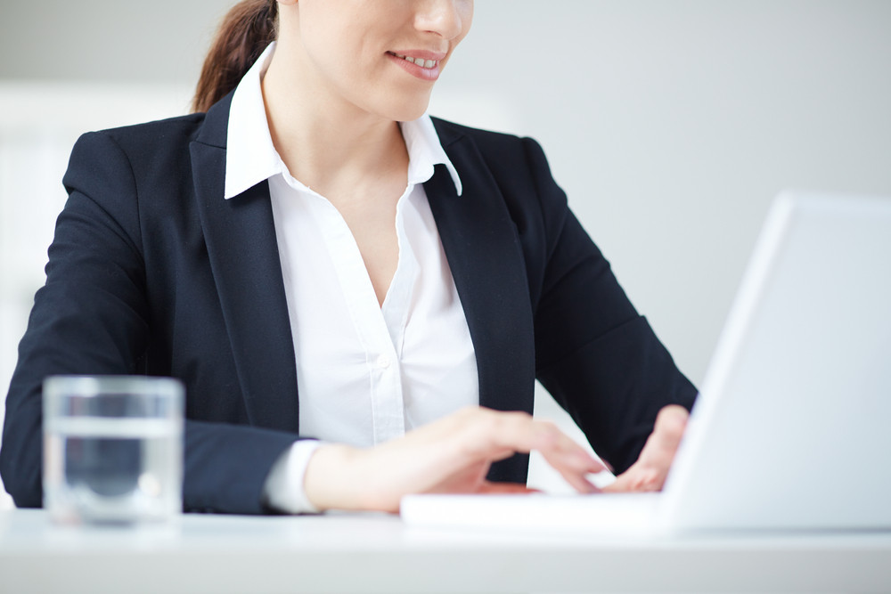 Young Businesswoman Typing In Office