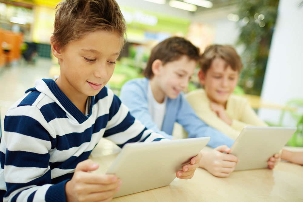 Schoolboys Studying With Touchpads