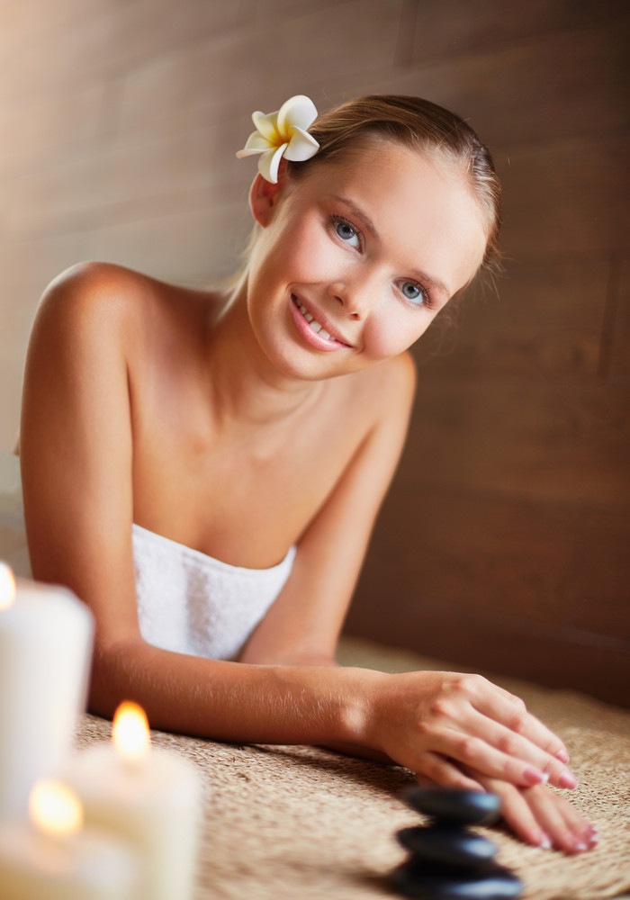 Portrait Of Young Female Ready For Massage Looking At Camera