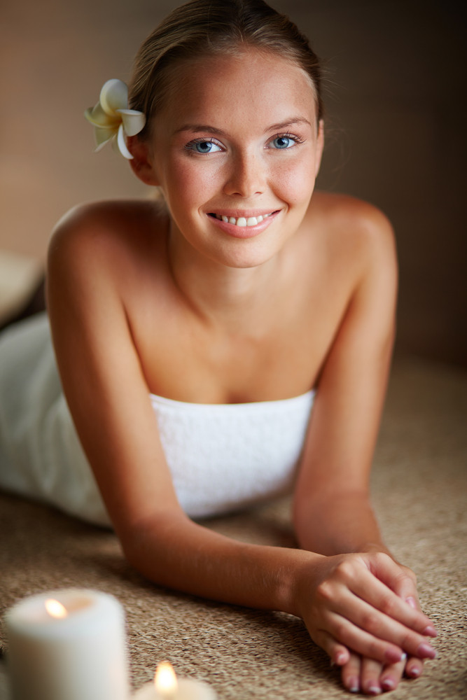 Portrait Of Young Female Looking At Camera While Relaxing In Spa Salon