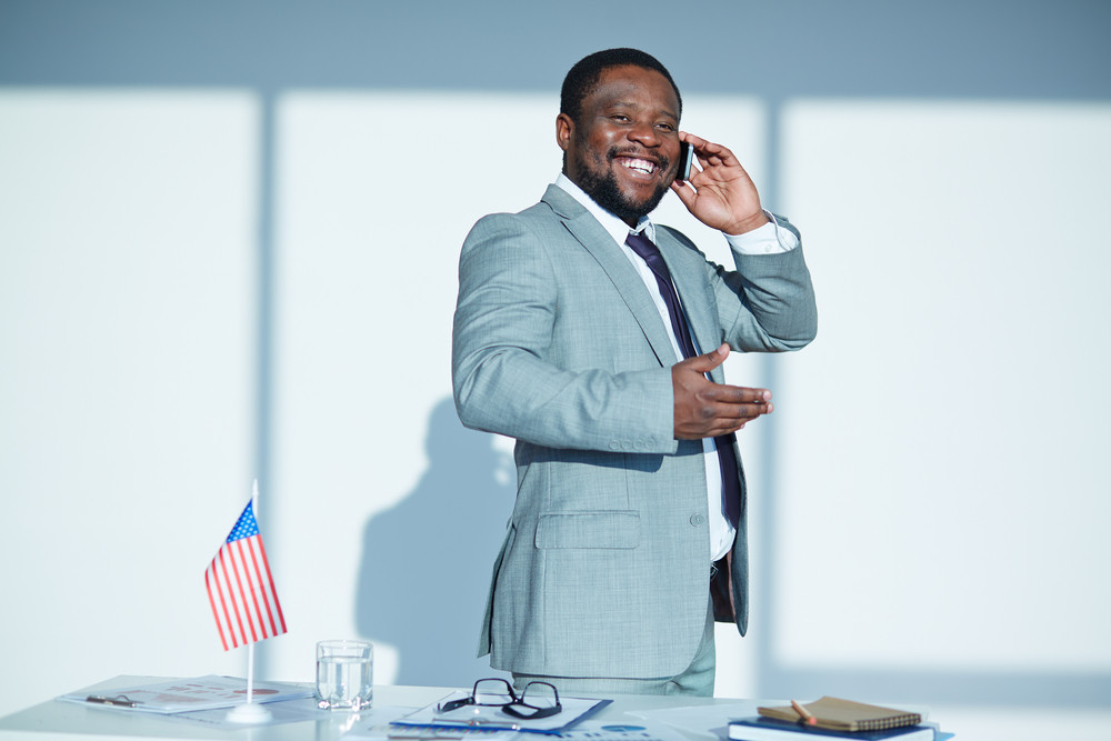 Cheerful Businessman In Formalwear Speaking On The Phone