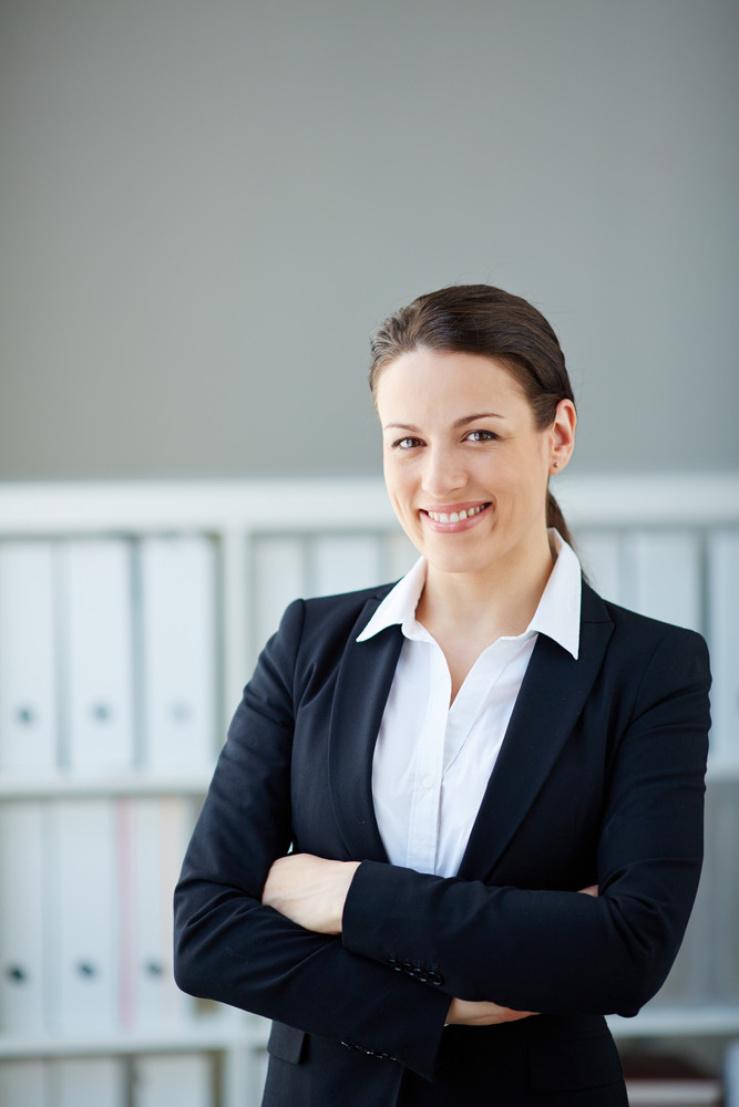 Young Businesswoman Looking At Camera In Office