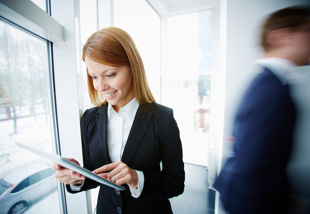 Image Of Successful Businesswoman Using Touchpad In Office